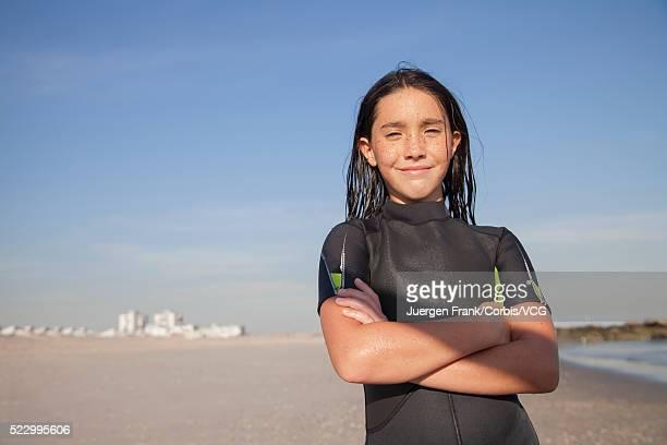 Portrait of teenage girl (13-15) in wetsuit