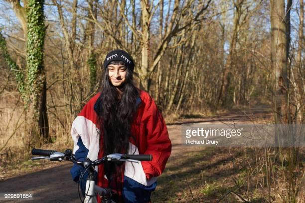Portrait of teenage girl on cycle track