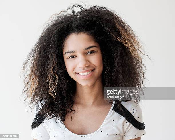 Portrait of teenage girl (16-17) on white background