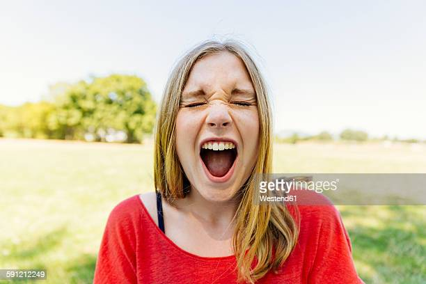 portrait of teenage girl outdoors screaming - mouth open stock pictures, royalty-free photos & images
