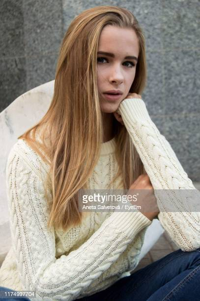 portrait of teenage girl sitting against wall - aneta eyeem stock pictures, royalty-free photos & images