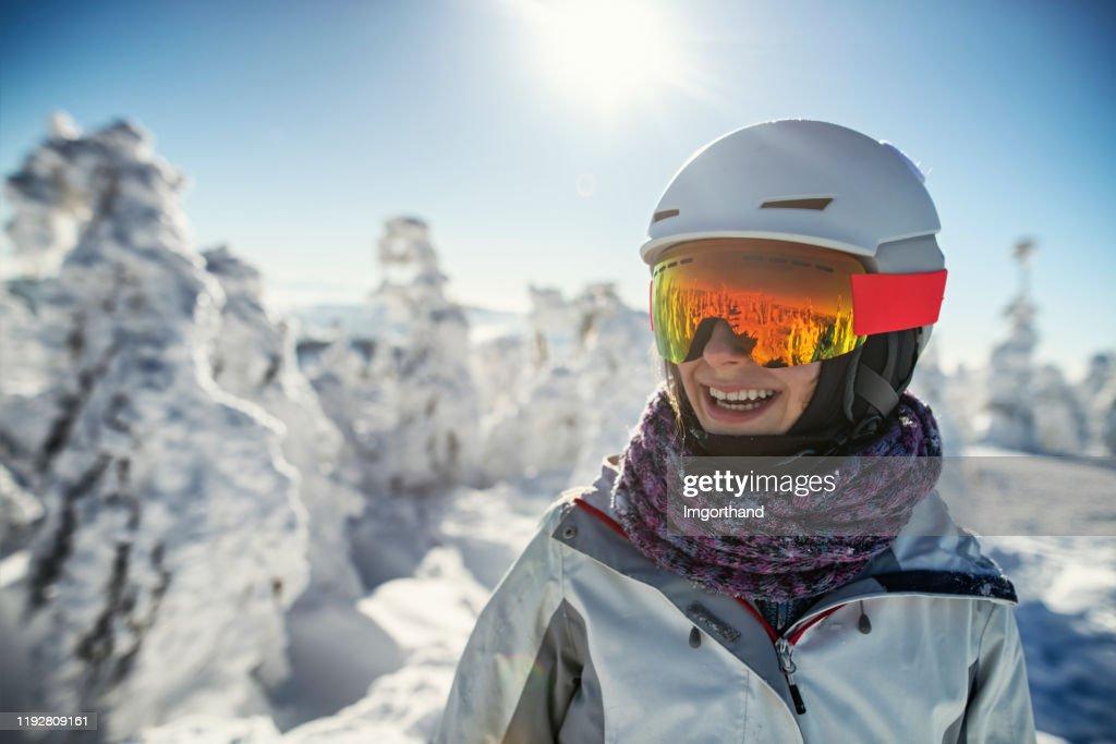 Portrait of teenage girl skiing on sunny winter day : Stock Photo