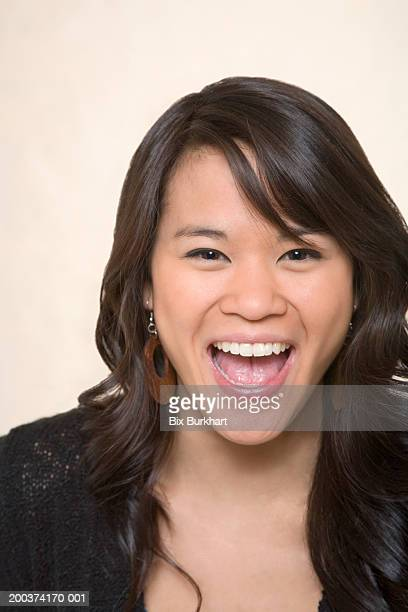 portrait of teenage girl (18-20), smiling with mouth open - girls open mouth stock photos and pictures