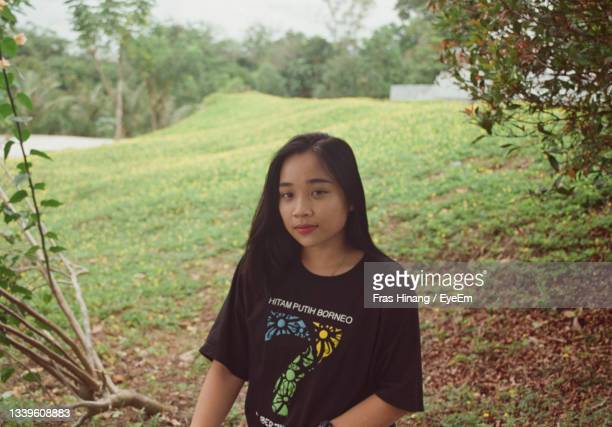 portrait of teenage girl standing on land - central kalimantan stock pictures, royalty-free photos & images