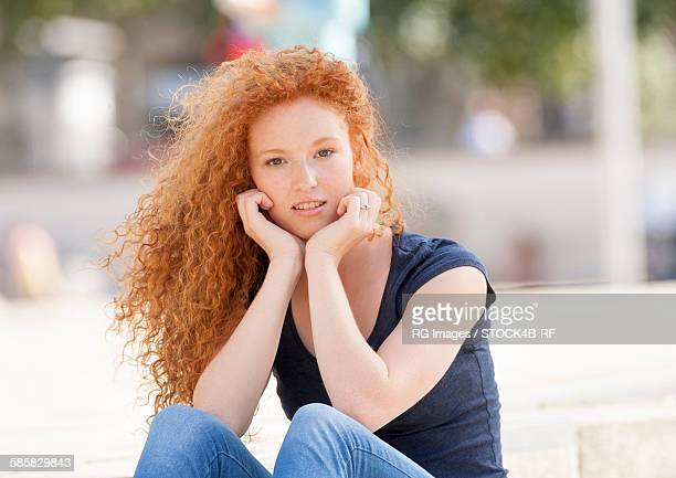 Portrait of teenage girl with curly red hair