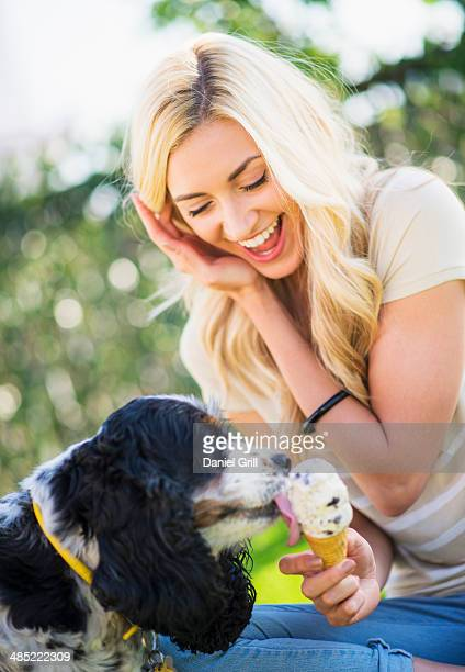 portrait of teenage girl (16-17) with dog licking ice cream - dog eats out girl stock photos and pictures