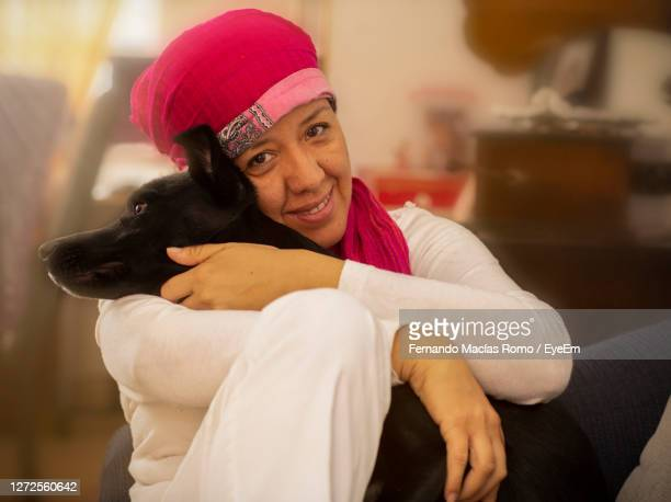 portrait of teenage girl with dog - dog knotted in woman stock pictures, royalty-free photos & images