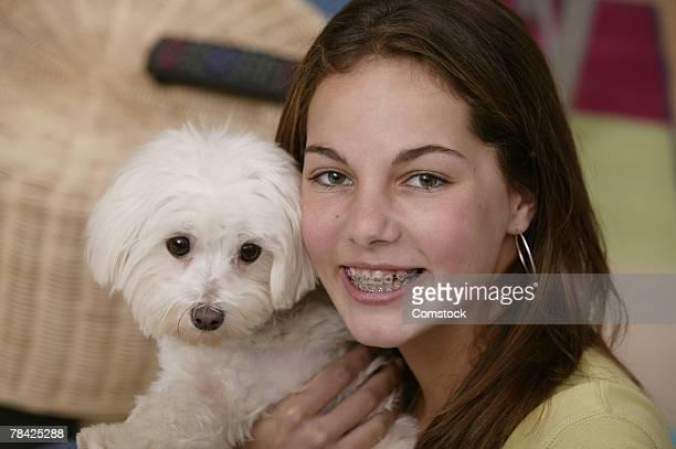 Portrait of teenage girl with dog