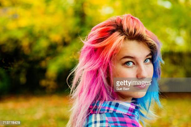 Portrait of teenage girl with multi-coloured hair, outdoors