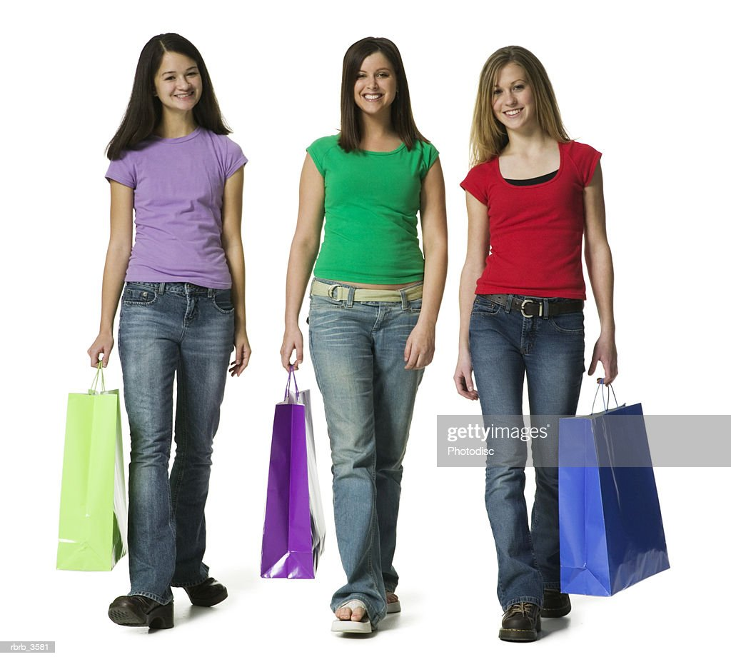 Portrait of teenage girls carrying shopping bags : Foto de stock
