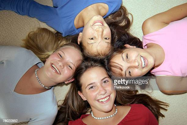 portrait of teenage girls lying down - thinkstock stock photos and pictures
