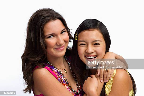 Portrait of teenage girls, smiling