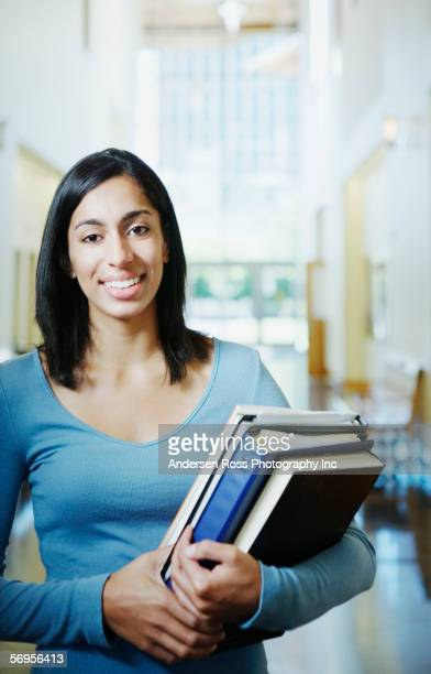 portrait of teenager with books - hot indian girls stock photos and pictures