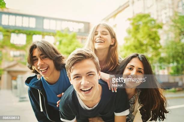 portrait of teenagers enjoying outdoors - jugendliche stock-fotos und bilder