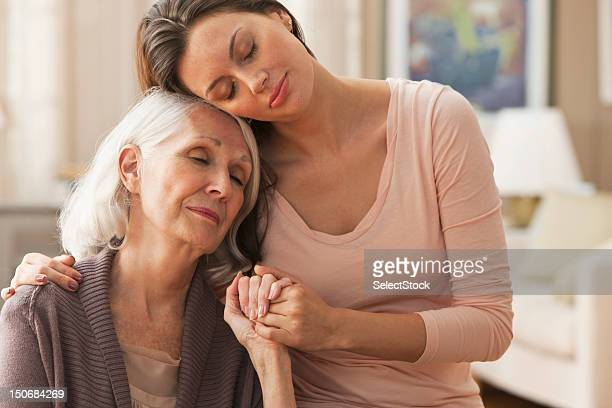 portrait of tender mother daughter moment - affectionate stock pictures, royalty-free photos & images