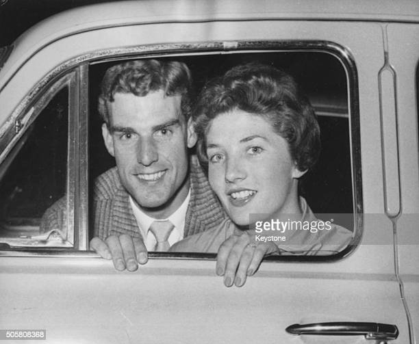 Portrait of tennis player Tony Pickard and his fiance Janet Sisson through the window their car pictured following his withdrawl from the British...