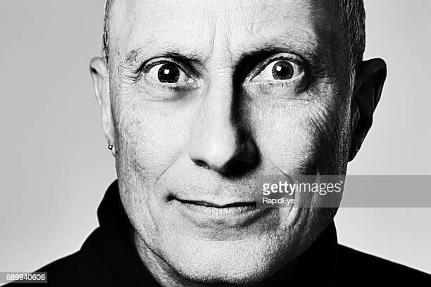 Portrait of tense, staring mature man in monochrome