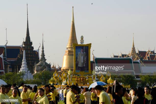 A portrait of Thailand's King Bhumibol Adulyadej as part of in memory of late Thai King Bhumibol Adulyadej on his birthday anniversary at Sanam Luang...