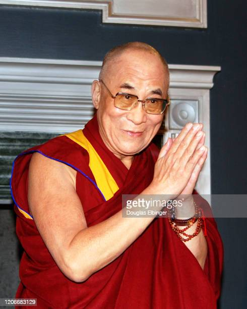 Portrait of the 14th Dalai Lama with his palms together, Ann Arbor, Michigan, April 18, 2004.