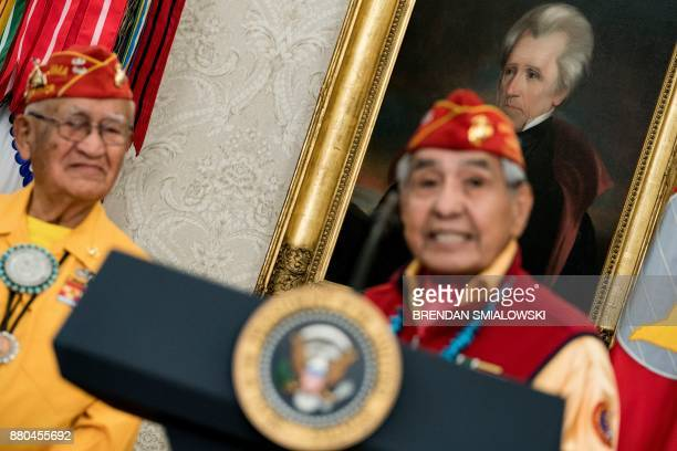 A portrait of the 7th US President Andrew Jackson who signed the Indian Removal Act is seen as a Navajo Code Talker speaks during an event in the...