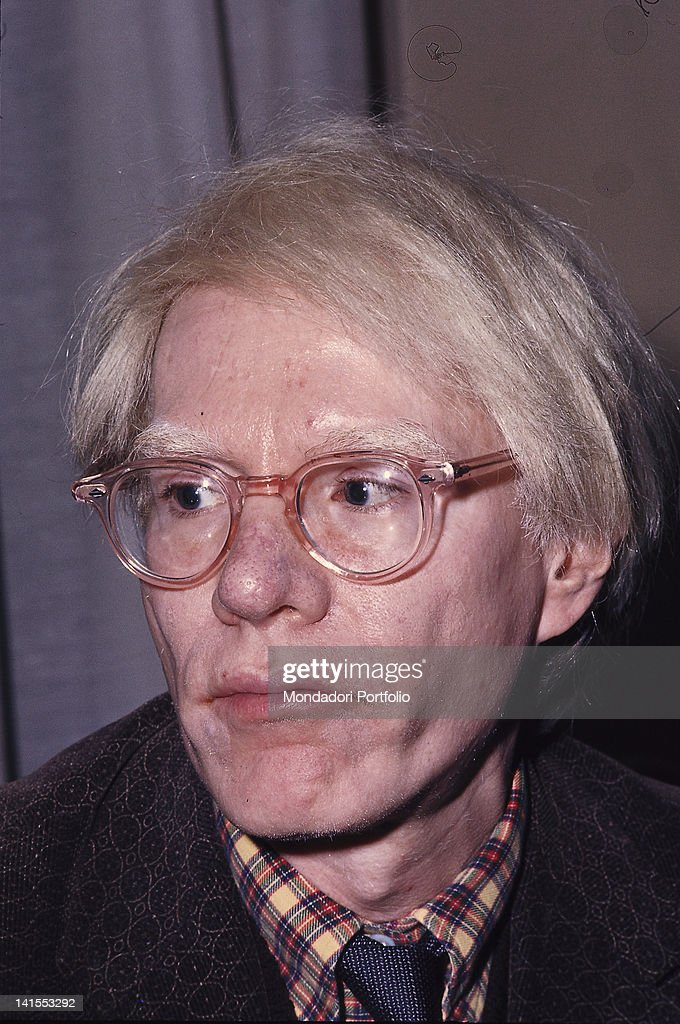 Portrait of the American artist Andy Warhol at his exhibition dedicated to Black transvestites in the US. Ferrara, November 1975