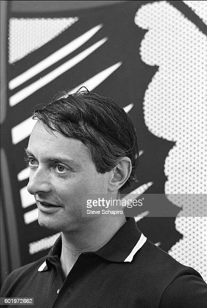 Portrait of the American artist Roy Lichtenstein as he stands in front of one of his paintings at the Venice Biennale Venice Italy 1966