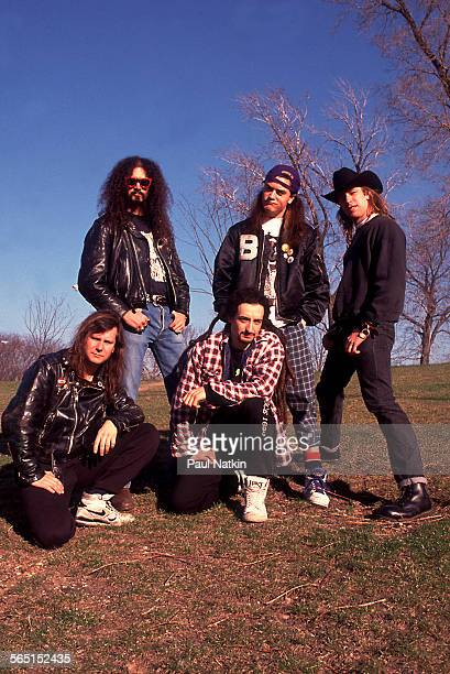 Portrait of the American band Faith No More, Chicago, Illinois, April 1, 1990. Pictured are, from row, from left Billy Gould and Mike Bordin; back...