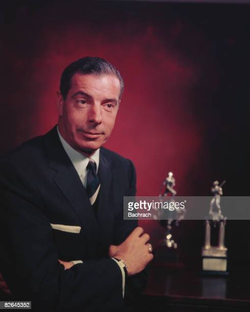 A portrait of the American baseball player Joe DiMaggio with two of his trophies New York 1954 During his career with the New York Yankees from 1936...