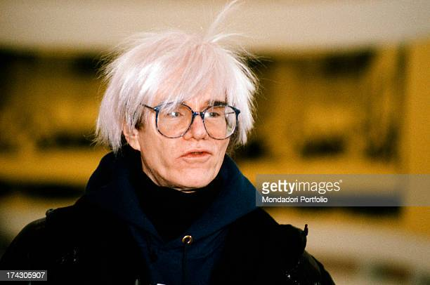Portrait of the American great artist and guru of Pop Art movement Andy Warhol born Andrew Warhola Junior with his typical hairstyle Italy the '80s