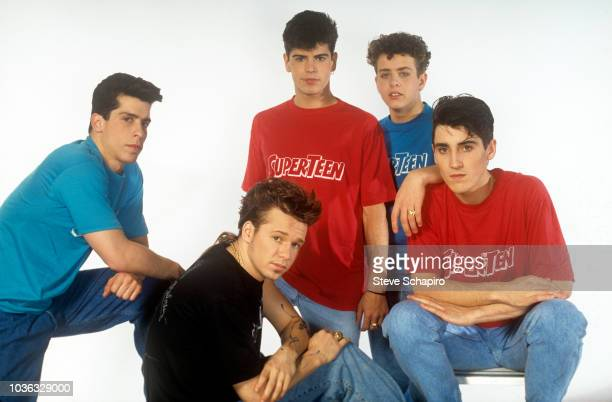 Portrait of the American pop group New Kids on the Block as they pose against a white background Los Angeles California 1989 From left Danny Wood...