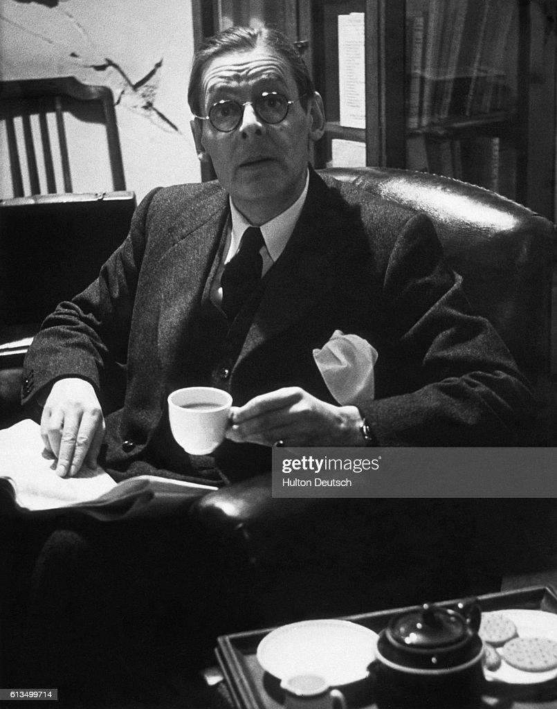 T.S. Eliot Enjoying Tea : News Photo