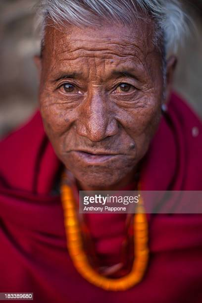 Portrait of the Angami tribe man wearing the traditional tunic and necklaces, near koyma, nagaland, india