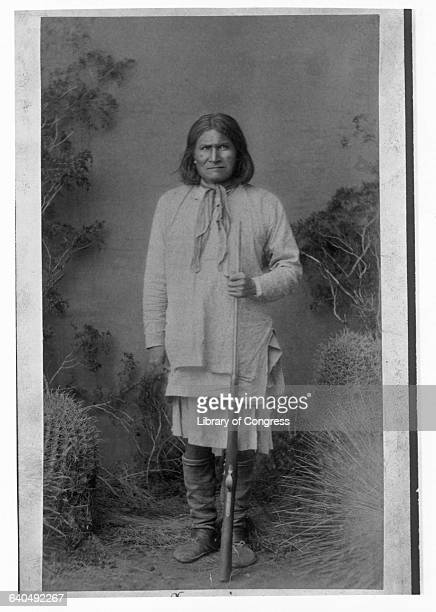 A portrait of the Apache war chief Geronimo holding a rifle