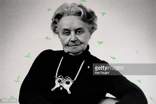 Portrait of the artist Hungarianborn artist Dora De PederyHunt wears her small sterling silver sculpture entitled The Kiss as a dramatic necklace...