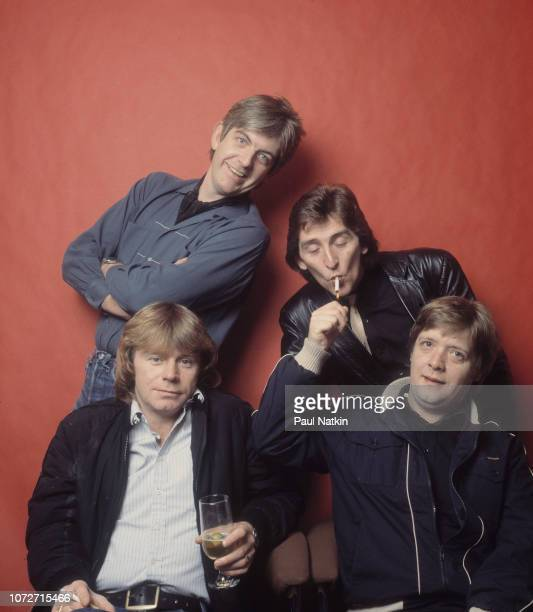 Portrait of the band Rockpile, clockwise from lower left, Dave Edmunds, Nick Lowe, Terry Williams, and Billy Bremner at the Riviera Theater in...