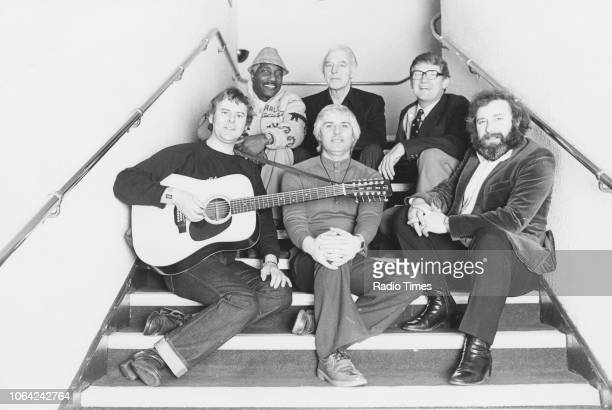Portrait of the band 'The Spinners' Hugh Jones Mick Groves Johnny McCormick with Cliff Hall and Tony Davis on a staircase posing with Bill Cartwright...