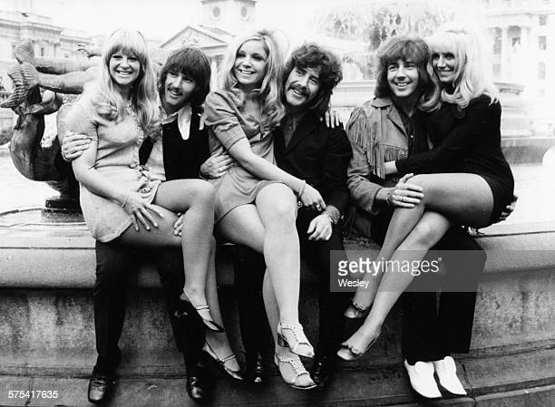 Portrait of the band 'The Tremeloes' with their three brides to be sitting on each of their laps Chip Hawks Carol Dilworth Alan Blakley Lyn Stevens...