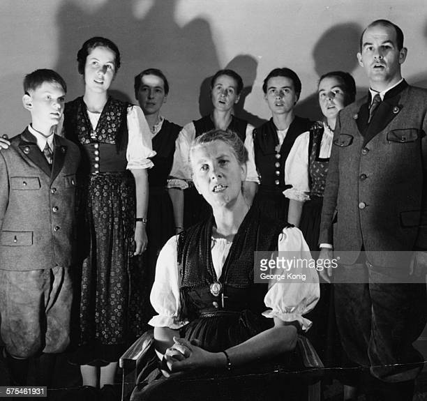 Portrait of the Baroness Maria Von Trapp singing with her children Johannes Eleonore Hedwig Martina Maria Rosemarie and Werner in London circa 1950