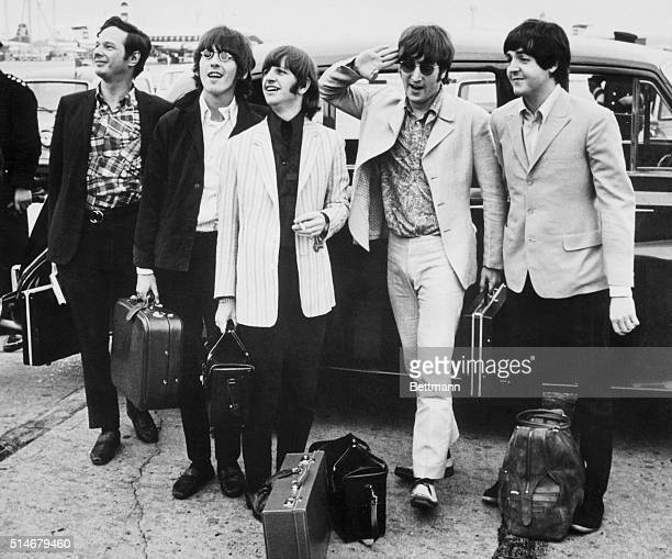 A portrait of The Beatles with their manager Brian Epstein arriving in London where they are welcomed by a crowd of two hundred fans