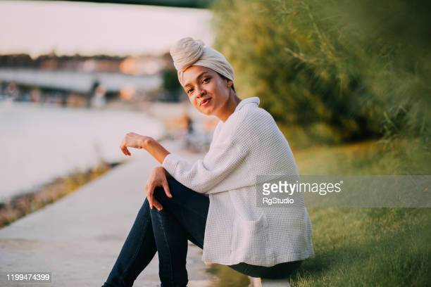 portrait of the beautiful arab girl enjoying by the river - international womens day stock pictures, royalty-free photos & images