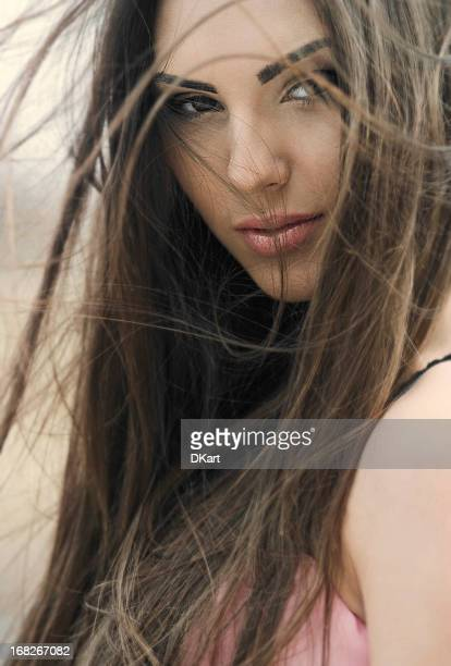 Portrait of the beautiful young girl with luxury brunet hair