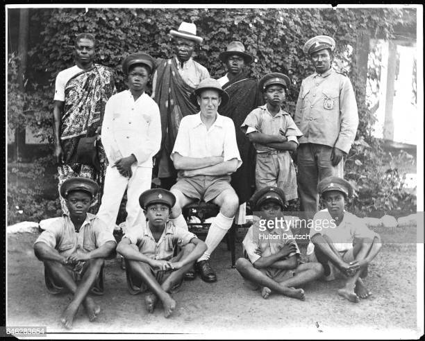 A portrait of the Bishop of Accra John Drefeur Aglionby with his attendants