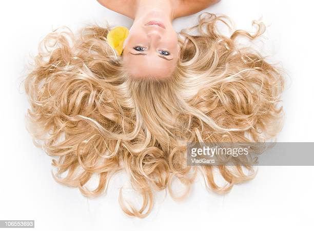 Portrait of the blonde with a long curly hair