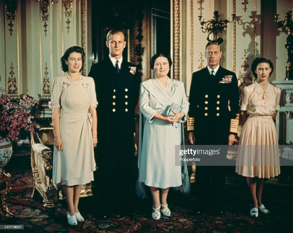 A portrait of the British royal family in the state apartments at Buckingham Palace to mark the engagement of Princess Elizabeth (later Queen Elizabeth II) and Philip Mountbatten (later Duke of Edinburgh), July 1947. Left to right: Princess Elizabeth, Philip Mountbatten, Queen Elizabeth the Queen Mother (1900 - 2002), King George VI (1895 - 1952) and Princess Margaret (1930 - 2002).