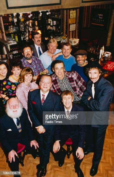 Portrait of the cast and crew on the pub set of episode 'Three Men a Woman and a Baby' of the BBC Television sitcom 'Only Fools and Horses' John...