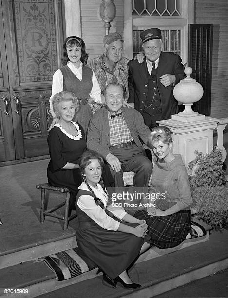 Portrait of the cast of 'Petticoat Junction' as they pose on the porch set during the filming of an episode entitled 'Visit From a Big Star' Los...