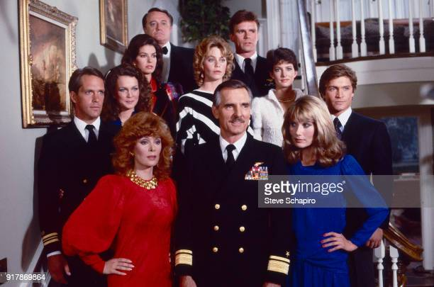 Portrait of the cast of the television series 'Emerald Point NAS' as they pose on a staircase Los Angeles California 1983 Pictured are fore from left...