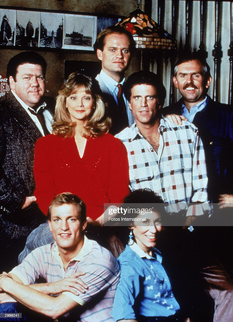 Portrait of the cast of the TV series, 'Cheers,' circa 1985. CW, L-R: George Wendt, Shelley Long, Kelsey Grammer, Ted Danson and John Ratzenberger. Front- Woody Harrelson and Rhea Perlman.