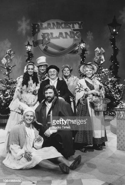 Portrait of the celebrity guests during the filming of the 'Blankety Blank' Christmas special including actresses Lorraine Chase Lynda Baron and...