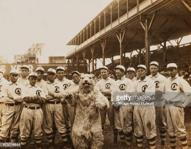 Portrait of the Chicago Cubs baseball team with the team's mascot as they pose on the field at West Side Grounds Chicago Illinois 1908